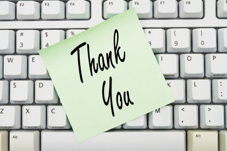 Computer keyboard keys with sticky note with words Thank You, Thank You for you online purchase Stock Photo - 21584599