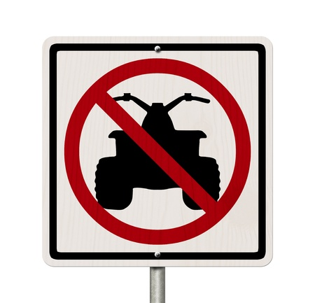 An American road sign isolated on white with a symbol of an ATV and restricted, No ATV allowed photo