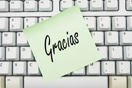 Computer keyboard keys with sticky note with words Gracias, Thank You for you online purchase in Spanish Stock Photo - 21585230