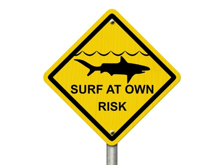 An warning sign isolated on white with shark symbol and words surf at own risk, Use caution when surfing because sharks are present  photo