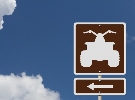 4x4: An American road sign with a symbol of an ATV and sky, Places to ride ATV Stock Photo