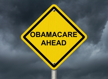 An warning sign against a stormy sky with words Obamacare Ahead, Warning about Obamacare