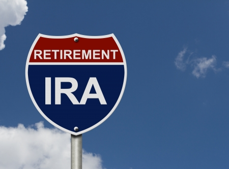 An American road interstate sign with words Retirement and IRA with sky, Your IRA Retirement Fund Stock Photo