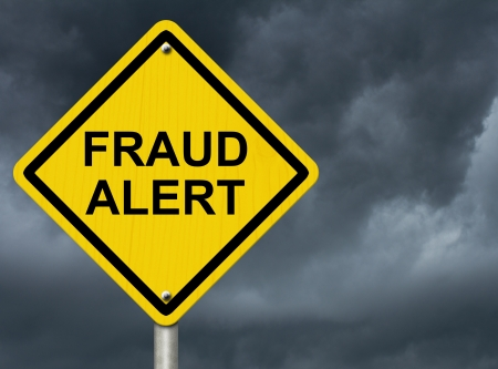 A road warning sign against a stormy sky with words Fraud Alert, Warning of Fraud Stock Photo - 21930625