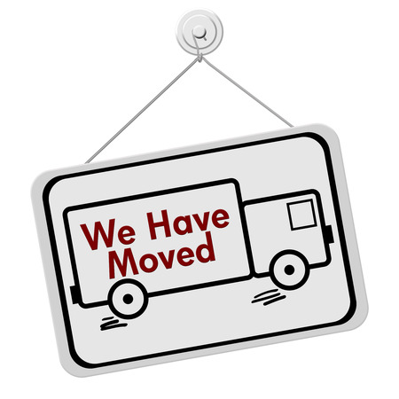 A white and black sign with the words We Have Moved and a truck isolated on a white background, We Have Moved Sign Stock Photo