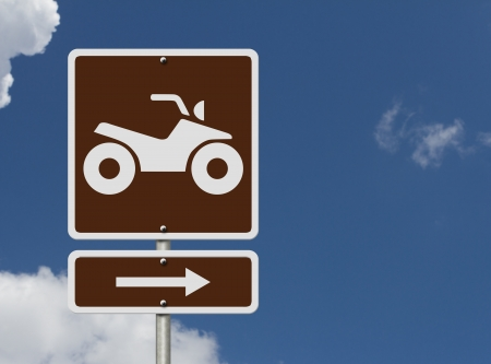 An American road sign with a symbol of an ATV and sky, Places to ride ATV photo