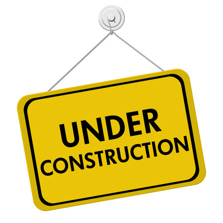 under construction: A yellow and black sign with the words Under Construction isolated on a white background, Under Construction Sign Stock Photo
