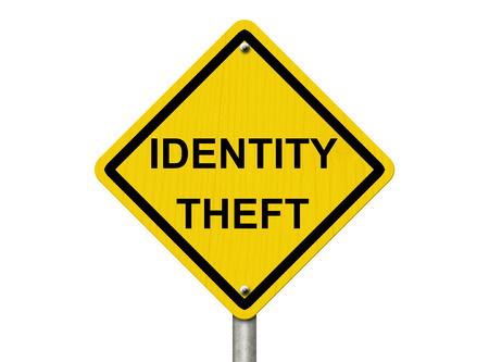 A road warning sign isolated on white with word Identity Theft, Warning of Identity Theft Stock Photo - 22520172