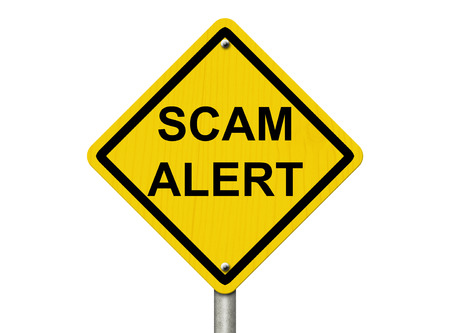 scam: A road warning sign isolated on white with words Scam Alert, Warning of a Scam
