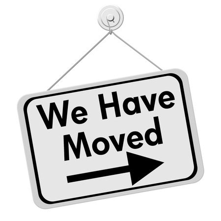 we have moved: A white and black sign with the words We Have Moved isolated on a white background, We Have Moved Sign Stock Photo