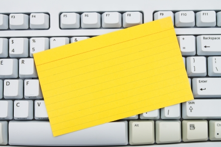Computer keyboard keys with blank index card with copy space, Create your own online message Stock Photo - 22680124