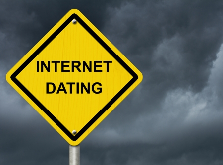 lie forward: A road warning sign against a stormy sky with words Internet Dating, Warning about Internet Dating Stock Photo