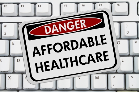 danger: Computer keyboard keys with danger sign with words Affordable Healthcare, Affordable Healthcare Stock Photo