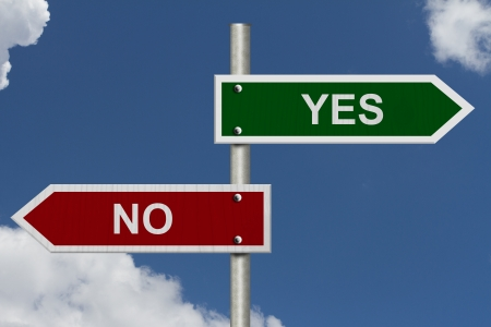 dilemma: Red and green street signs with blue sky with words Yes and No, Yes versus No