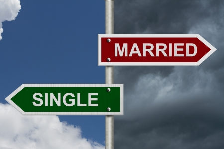 single word: Red and green street signs with blue and stormy sky with words Married and Single, Married versus Single Stock Photo