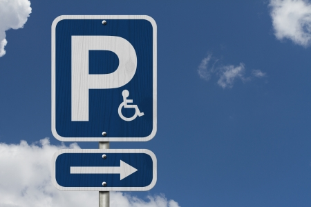disabled parking sign: An Blue American road sign with a P, a wheelchair and arrow with sky background, HandicapParking Sign