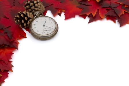 Red Autumn Leaves, Watch and a Pine Cones Background isolated on white for copy-space, Autumn Time Background photo