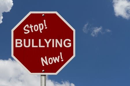 intimidation: An American road sign and words Stop Bullying Now with sky background, Stop Bullying Now Sign