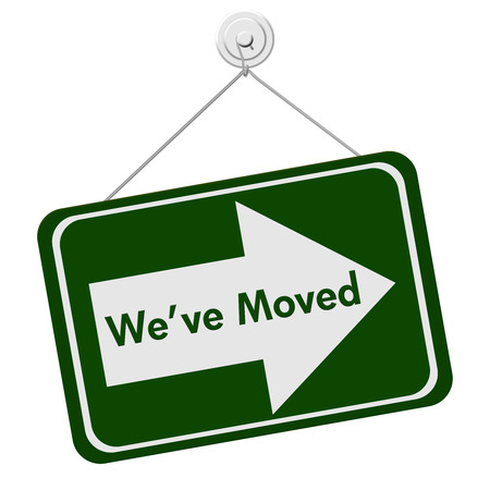 moved: A green and white sign with the words We Have Moved isolated on a white , We Have Moved Sign Stock Photo
