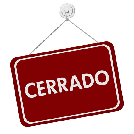 shop sign: A red and white sign with the word Cerrado Closed isolated on a white background, Cerrado Closed Sign Stock Photo