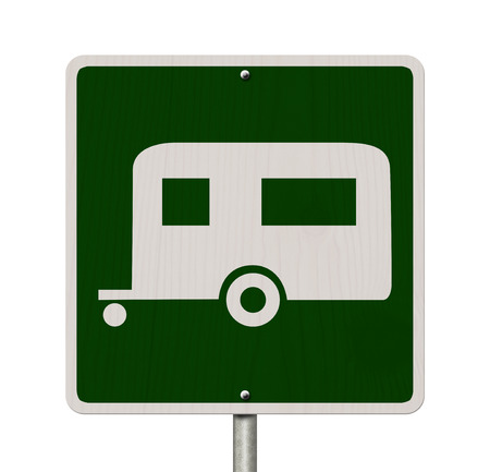 An American road sign isolated on white with a symbol of a camper, Going camping photo