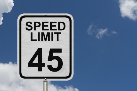 kilometre: A white American road sign with words Speed Limit and 45 with sky background, Speed Limit 45 Sign