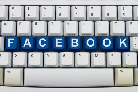 inform information: Computer keyboard keys with word Facebook, Sharing on facebook