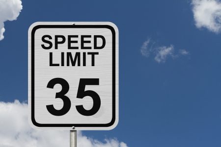 traffic rules: A white American road sign with words Speed Limit and 35 with sky background, Speed Limit 35 Sign