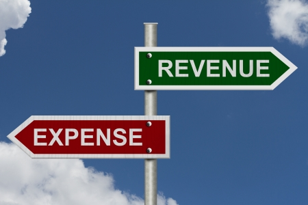 expenses: Red and green street signs with blue sky with words Revenue and Expense, Revenue versus Expense Stock Photo