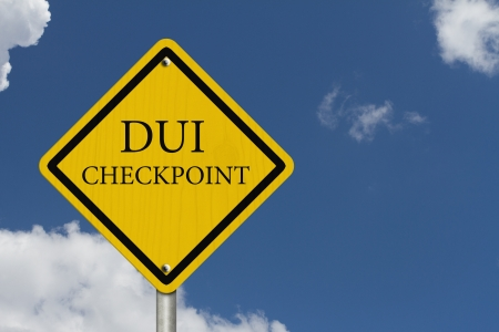 sobriety: Stop Drinking and Driving, An American road warning sign with words DUI Checkpoint with blue sky Stock Photo