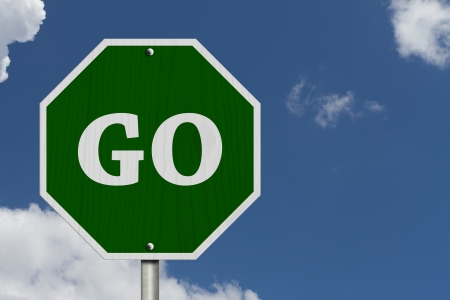 go to: Go Sign, An American road sign and words Go with blue sky Stock Photo