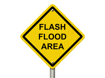 A road warning sign isolated on white with words Flash Flood Area, Flood Warning