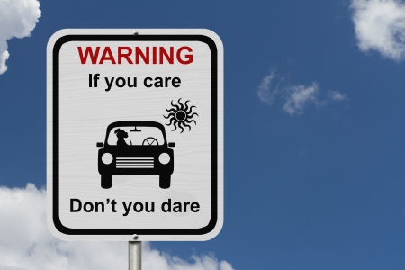 Dangers of leaving a dog in parked cars, A white road sign with the message of the danger with blue sky Stock Photo - 25192217