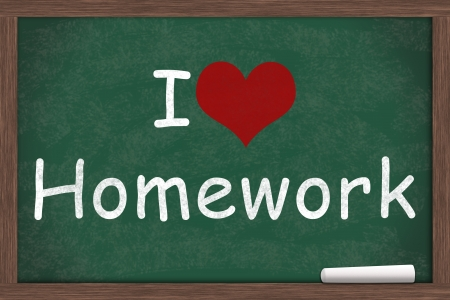 i like my school: I love Homework, I heart Homework written on a chalkboard with a piece of white chalk Stock Photo