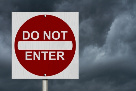 do not enter: Do Not Enter Sign, A Square American road warning sign with words Do Not Enter with stormy sky Stock Photo