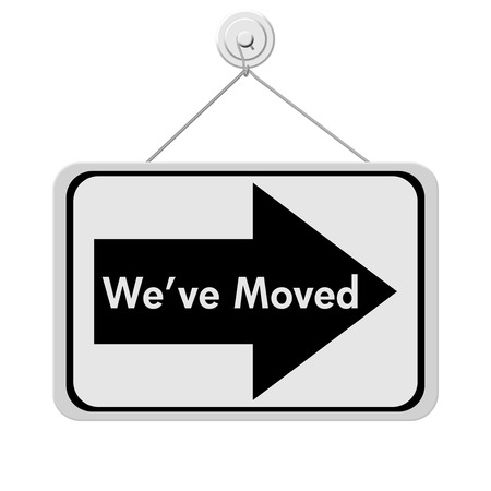 A black and white sign with the words We Have Moved and arrow isolated on a white background, We Have Moved Sign Stock Photo