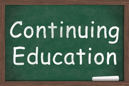 ed: Continuing Education written on a chalkboard with a piece of white chalk Stock Photo
