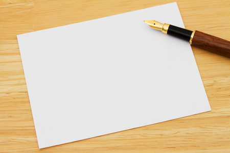 note card: A blank card with a fountain pen on a wooden desk, Writing a Personal Note