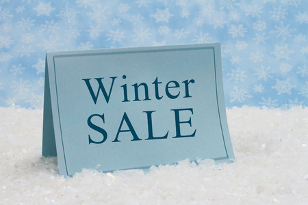 Winter Sale Message,A blue blank card on snow and a blue snowflake photo