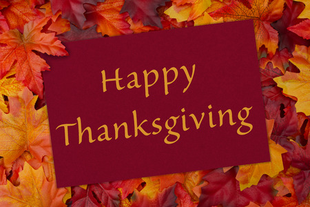 message: A Happy Thanksgiving card, A red card with words thank you over red and orange maple leaf background