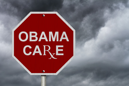 An American road stop sign with word Obama Care with a stormy sky background photo