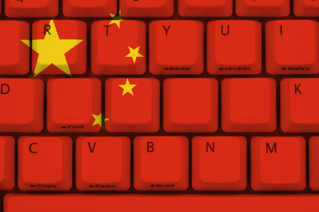 firewall: Computer keyboard the Chinese flag on it
