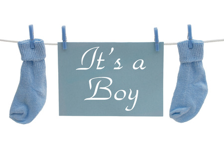 its a boy: A blue blank card hanging on line with socks isolated on a white background