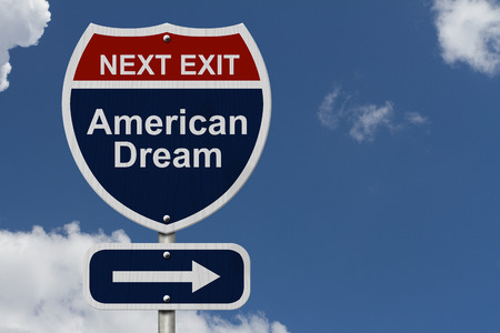 American Dream this way, Blue and Red Interstate Sign with word American Dream and an arrow with sky background Stock Photo
