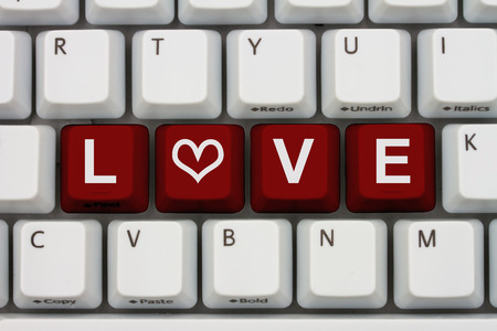 love affair: Internet Dating, Computer keyboard keys with word love and a heart Stock Photo