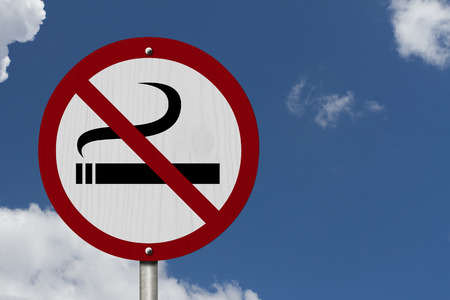 No Smoking Allowed Sign, An red road sign with cigarette icon and not symbol with blue sky background photo