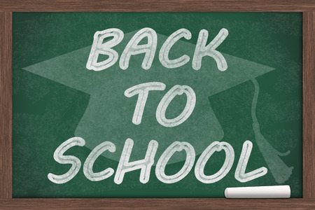 Back to School Message, Back to School written on a chalkboard with chalk and a grad cap