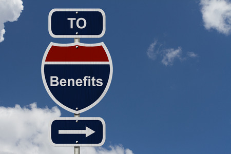 Benefits this way, Blue and Red Interstate Sign with word benefits and an arrow with sky background Zdjęcie Seryjne