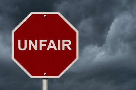 unfair: Unfair Sign, Red Stop sign with word Unfair with stormy sky background