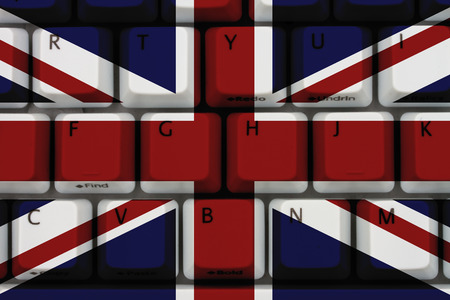 inform information: Internet in England, Computer keyboard the British flag on it Stock Photo